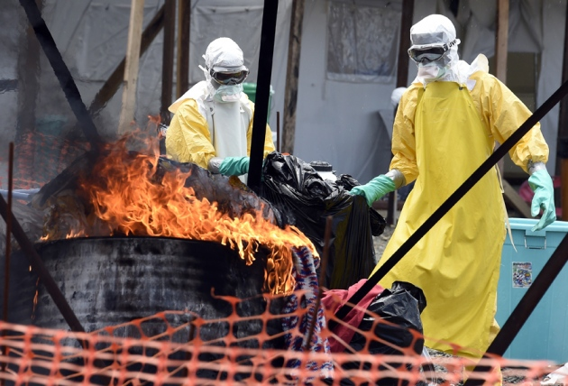 Pascal Guyot/AFP/Getty - Some Ebola control measures are causing local people to fear health-care workers.
