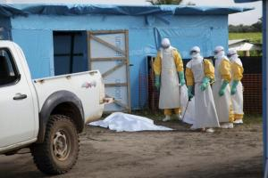 Health workers, wearing head-to-toe protective gear, prepare for work outside an isolation unit in Foya District, Lofa County, Liberia, July 2014. REUTERS/Ahmed Jallanzo