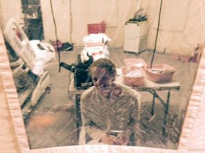 "This Sunday, Oct. 26, 2014 photo provided by attorney Steven Hyman shows nurse Kaci Hickox in an isolation tent at University Hospital in Newark, N.J., where she was quarantined after flying into Newark Liberty International Airport following her work in West Africa caring for Ebola patients. On Monday New Jersey officials said Hickox was being released, had been symptom-free for 24 hours and would be taken on a private carrier to Maine. Hickox had complained about her treatment in New Jersey and in a telephone interview with CNN said she did not initially have a shower, flushable toilet, television or reading material in the special tent she was placed in. Scientists attending American Society of Tropical Medicine and Hygiene convening in New Orleans this weekend say states are taking the science out of public health policies. Attendees to the conference that starts here Sunday were warned by the state that ""in an abundance of caution"" anyone who has been in West Africa in the last 21 days is banned from traveling to Louisiana — even if they have no symptoms of Ebola — and will be quarantined in their hotel room if they do. (AP Photo/Steven Hyman)"